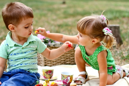 Caucasian little boy and girl in the park Stock Photo