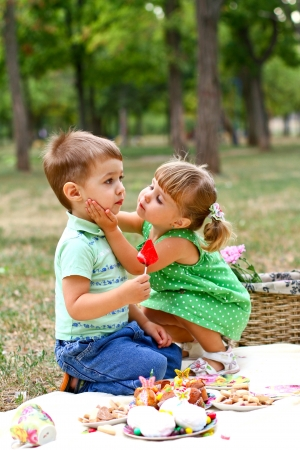 Caucasian little boy and girl in the park Imagens