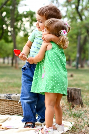 brother sister: Caucasian little boy and girl in the park Stock Photo