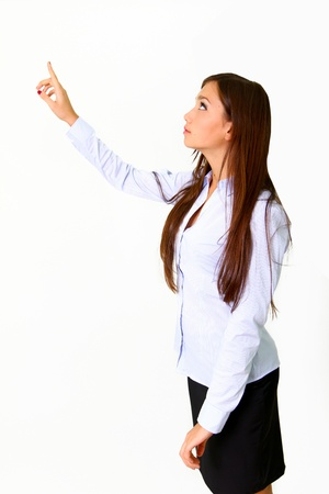 Young business woman pushing or pointing a transparent screen isolated on white background photo