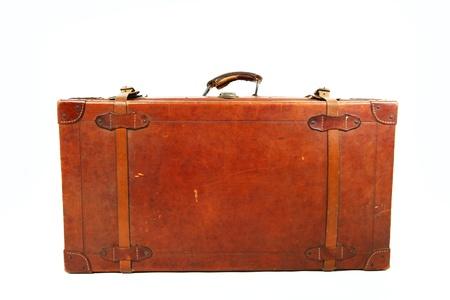 Oude koffer geà ¯ soleerd op een witte achtergrond