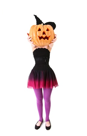 A young woman in a witch costume with a pumpkin instead of head photo