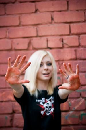 Teenager against brick wall photo
