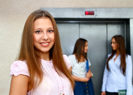 Three young women near the elevator photo