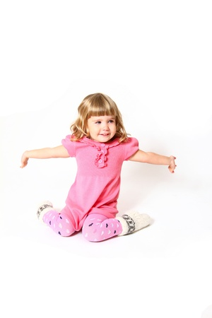 Happy little girl in a pink dress laughing Stock Photo - 16669101