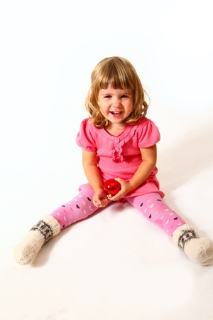 Laughing baby with red ball sitting Stock Photo - 16669103