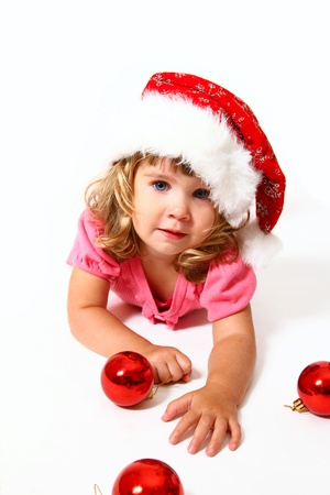 New Year or Christmas sweet baby with Santa Claus hat and red balls photo