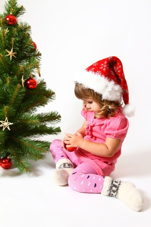 Sweet baby decorate  the New Year or  a Christmas tree photo