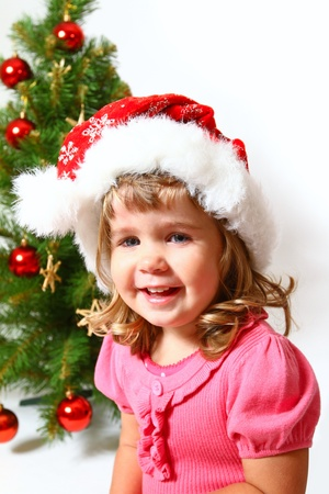 Laughing baby near decorated New Year or  Christmas tree photo