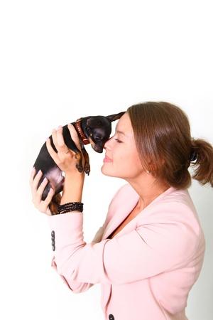 Pretty girl holding a black Chihuahua Stock Photo - 17213364