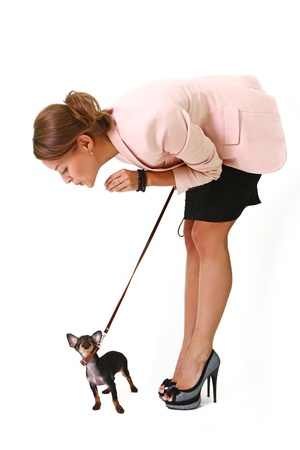 Pretty young woman holding a black Chihuahua on a leash Stock Photo - 17213362