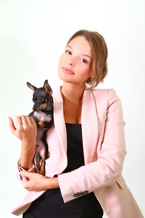 Seductive young woman holding a black Chihuahua Stock Photo - 17213365