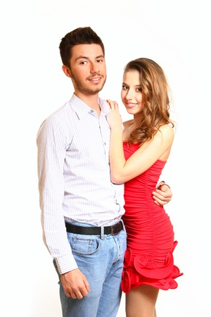 Boy hugging girl in a red dress photo