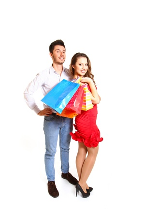 Fashion young happy couple with shopping bags photo