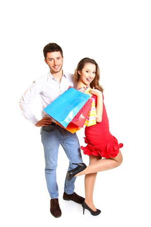 Young happy couple with shopping bags posing Stock Photo - 17594673