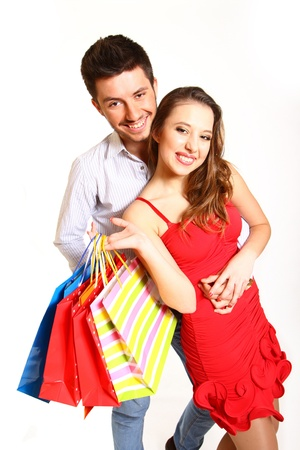 Young couple with shopping bags hugging photo