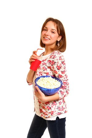 Pretty smiling girl with popcorn and a cup photo
