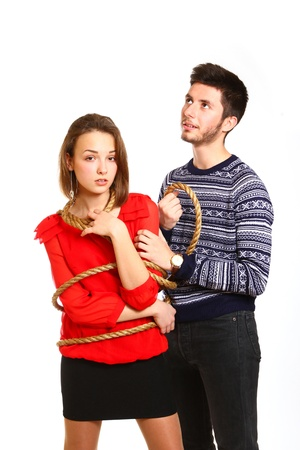 Portrait of boy and  tied girl with rope photo