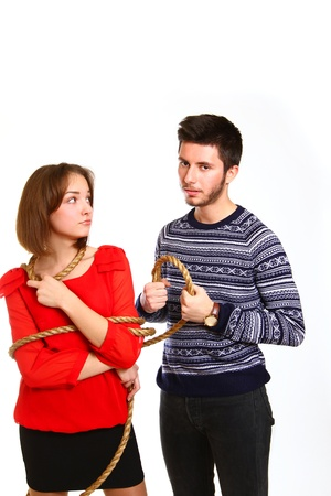 Angry boy and  girl tied with rope photo