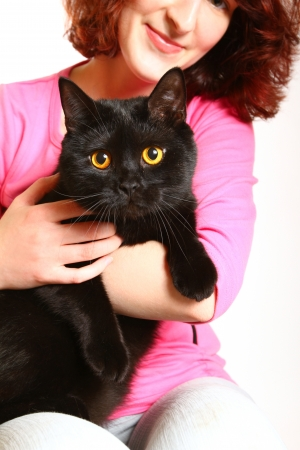 Portrait of smiling young woman with black British cat photo