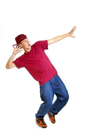 gente bailando: Retrato de joven bailarín de breakdance fresco posando aislado sobre fondo blanco