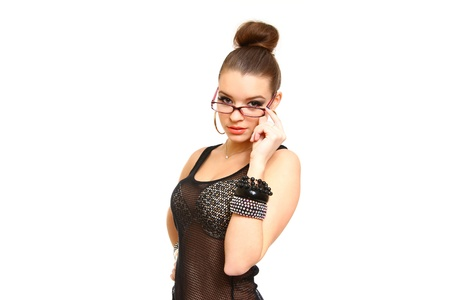 Sexy brunette girl with glasses looking at the camera photo
