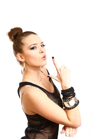 Sexy young woman making a gun gesture photo