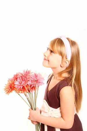 Happy little girl with flowers in beautiful dress Stock Photo - 18008951