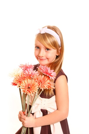 Cute blonde little girl with flowers Stock Photo - 18008945
