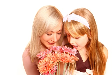 olfaction: Mother and daughter sniffing flowers Stock Photo