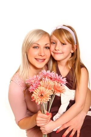 Hugging mother and daughter with flowers Stock Photo - 18008938