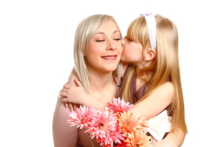 Daughter giving flowers and kissing her mother Stock Photo - 18008939
