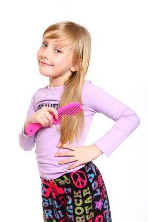 Little smiling girl combing her long beautiful hair Stock Photo - 18008948