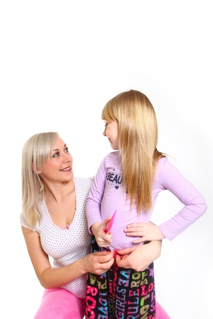 Happy mother and daughter with a comb looking at each other and hugging Stock Photo - 18034586