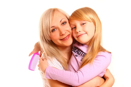 Portrait og hugging mother and daughter with a comb close up Stock Photo - 18034557