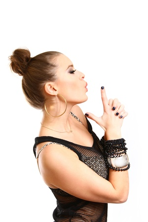 Sexy young woman making gun gesture and blowing on the index finger photo