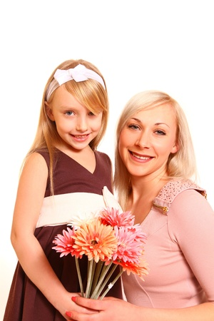 Portrait of smiling little girl and woman with flowers on a white background photo