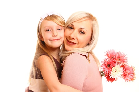 Daughter and her mother with flowers on a white background hugging photo