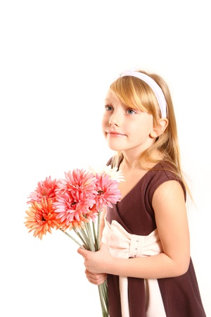 Portrait of little girl with gerberas on white background photo