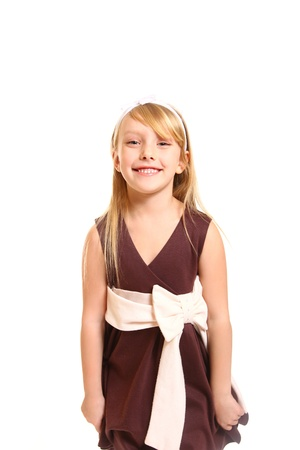 Portrait of laughing little girl in a dress  photo