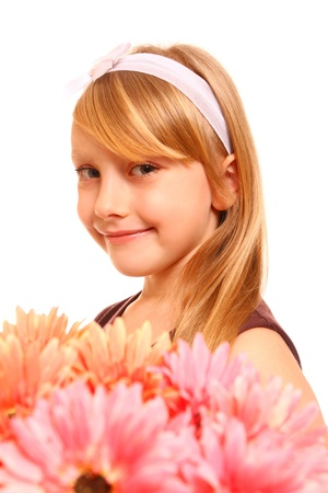 Cute little girl with flowers gerberas on a white background photo