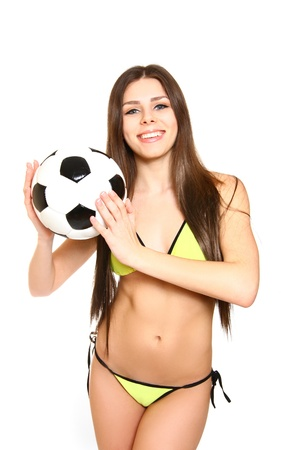 Happy young woman posing with a soccer ball on  white background photo