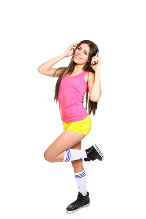 cool girl: Happy young woman listening to music with headphones on white background Stock Photo