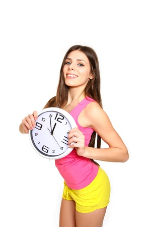 Portrait of a young woman with clock, a time for sports photo