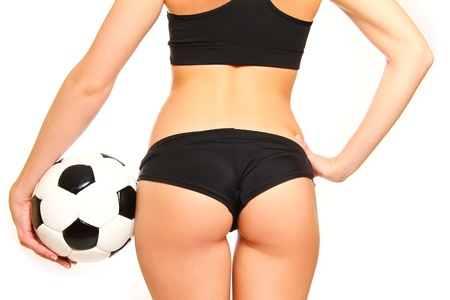 back  ass: Woman standing with a soccer ball on  white background, rear view