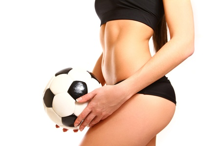 Midsection of fit woman in sportswear with soccer ball posing photo