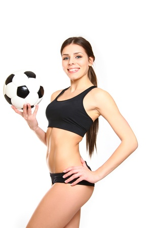 Athletic woman posing with a soccer ball on white background photo