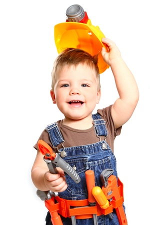 Happy little boy in an orange helmet and tools on  white background