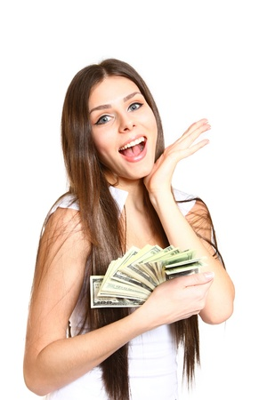 Happy young woman holding dollars on  white background photo