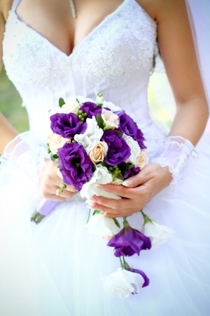 purple dress: Bride with a beautiful bouquet